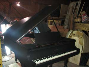 Steinway model M, new, ebonized satin finish with new key tops, C. 1934
